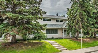 Photo 2: 113 4525 31 Street SW in Calgary: Rutland Park Row/Townhouse for sale : MLS®# C4303523