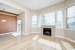 Photo 11: 22 Straddock Villas SW in Calgary: Strathcona Park Semi Detached for sale : MLS®# A1038365