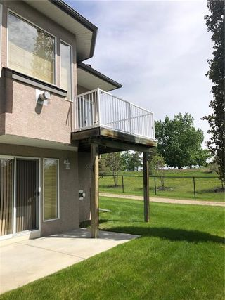 Photo 46: 22 Straddock Villas SW in Calgary: Strathcona Park Semi Detached for sale : MLS®# A1038365