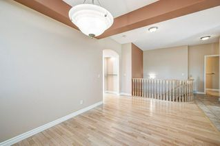 Photo 7: 22 Straddock Villas SW in Calgary: Strathcona Park Semi Detached for sale : MLS®# A1038365