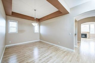 Photo 5: 22 Straddock Villas SW in Calgary: Strathcona Park Semi Detached for sale : MLS®# A1038365