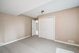 Photo 35: 22 Straddock Villas SW in Calgary: Strathcona Park Semi Detached for sale : MLS®# A1038365