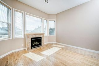 Photo 12: 22 Straddock Villas SW in Calgary: Strathcona Park Semi Detached for sale : MLS®# A1038365