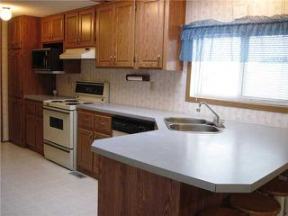 """Photo 3: 22 8420 ALASKA Road in Fort St. John: Fort St. John - City SE Manufactured Home for sale in """"PEACE COUNTRY MOBILE HOME PARK"""" (Fort St. John (Zone 60))  : MLS®# N225043"""