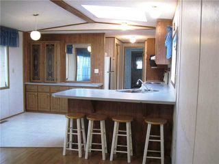 """Photo 2: 22 8420 ALASKA Road in Fort St. John: Fort St. John - City SE Manufactured Home for sale in """"PEACE COUNTRY MOBILE HOME PARK"""" (Fort St. John (Zone 60))  : MLS®# N225043"""