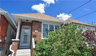 Photo 1: Danforth Village Bungalow