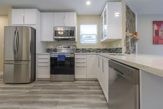 """Photo 1: 68 15875 20 Avenue in Surrey: King George Corridor Manufactured Home for sale in """"Searidge Bays"""" (South Surrey White Rock)  : MLS®# R2412916"""