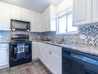 Photo 5: 404 2733 ATLIN PLACE in Coquitlam: Coquitlam East Condo for sale : MLS®# R2419896