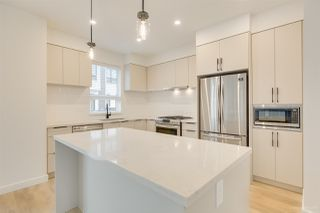 "Photo 2: 104 3021 ST GEORGE Street in Port Moody: Port Moody Centre Townhouse for sale in ""GEORGE"" : MLS®# R2474134"