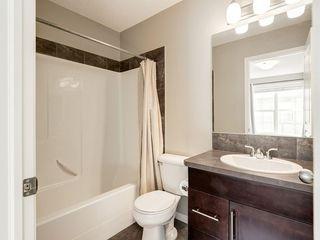 Photo 9: 158 NEW BRIGHTON Villas SE in Calgary: New Brighton Row/Townhouse for sale : MLS®# A1011356