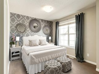 Main Photo: 158 NEW BRIGHTON Villas SE in Calgary: New Brighton Row/Townhouse for sale : MLS®# A1011356