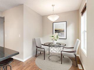 Photo 5: 158 NEW BRIGHTON Villas SE in Calgary: New Brighton Row/Townhouse for sale : MLS®# A1011356