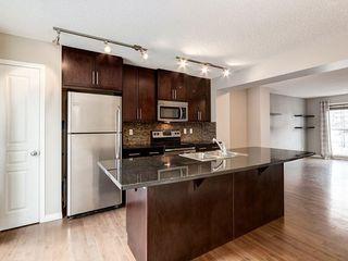 Photo 4: 158 NEW BRIGHTON Villas SE in Calgary: New Brighton Row/Townhouse for sale : MLS®# A1011356