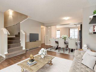 Photo 2: 158 NEW BRIGHTON Villas SE in Calgary: New Brighton Row/Townhouse for sale : MLS®# A1011356