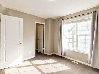 Photo 11: 158 NEW BRIGHTON Villas SE in Calgary: New Brighton Row/Townhouse for sale : MLS®# A1011356