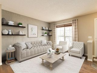 Main Photo: 158 NEW BRIGHTON Villas SE in Calgary: New Brighton Row/Townhouse for sale : MLS®# A1011356