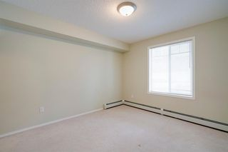 Photo 9: 5108 70 Panamount Drive NW in Calgary: Panorama Hills Apartment for sale : MLS®# A1057254