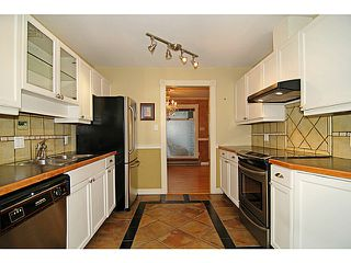 "Photo 6: # 203 2733 ATLIN PL in Coquitlam: Coquitlam East Condo for sale in ""ATLIN COURT"" : MLS®# V1025268"