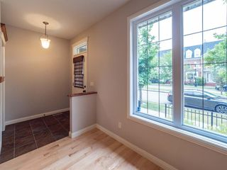Photo 4: 2960 PEACEKEEPERS Way SW in Calgary: Garrison Green Row/Townhouse for sale : MLS®# A1033723