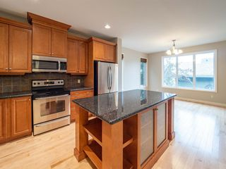 Photo 13: 2960 PEACEKEEPERS Way SW in Calgary: Garrison Green Row/Townhouse for sale : MLS®# A1033723