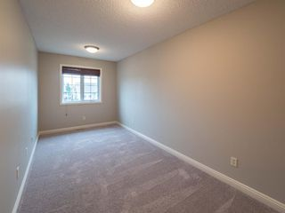 Photo 29: 2960 PEACEKEEPERS Way SW in Calgary: Garrison Green Row/Townhouse for sale : MLS®# A1033723