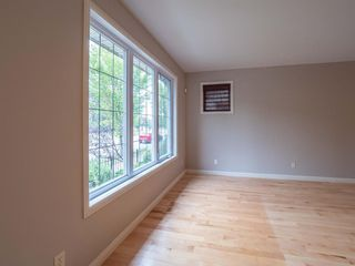 Photo 5: 2960 PEACEKEEPERS Way SW in Calgary: Garrison Green Row/Townhouse for sale : MLS®# A1033723