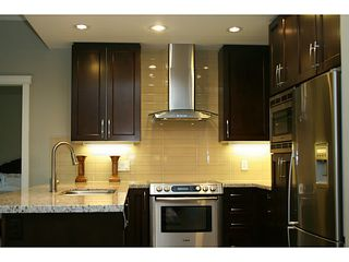 Photo 3: # 705 1415 PARKWAY BV in Coquitlam: Westwood Plateau Condo for sale : MLS®# V1110552