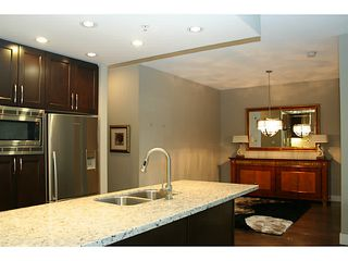 Photo 4: # 705 1415 PARKWAY BV in Coquitlam: Westwood Plateau Condo for sale : MLS®# V1110552