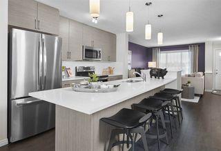 Photo 1: 1075 Paisley Drive in Edmonton: Zone 55 House Half Duplex for sale : MLS®# E4179826