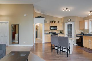 Photo 7: 206 7 EVERRIDGE Square SW in Calgary: Evergreen Row/Townhouse for sale : MLS®# A1037187