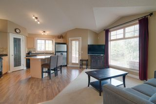 Photo 10: 206 7 EVERRIDGE Square SW in Calgary: Evergreen Row/Townhouse for sale : MLS®# A1037187