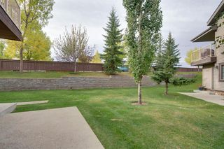Photo 2: 206 7 EVERRIDGE Square SW in Calgary: Evergreen Row/Townhouse for sale : MLS®# A1037187