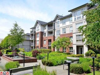 Photo 1: 106 15188 22ND Avenue in Surrey: Sunnyside Park Surrey Condo for sale (South Surrey White Rock)  : MLS®# F1225182