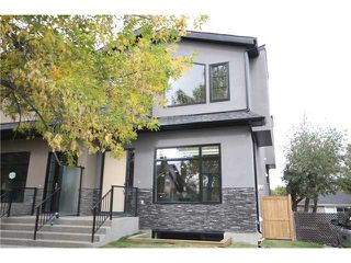 Photo 1: 724 24 Avenue NW in CALGARY: Mount Pleasant Residential Attached for sale (Calgary)  : MLS®# C3583600
