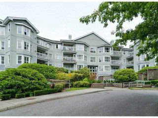 "Photo 18: 306 13955 LAUREL Drive in Surrey: Whalley Condo for sale in ""King George Manor"" (North Surrey)  : MLS®# F1422103"