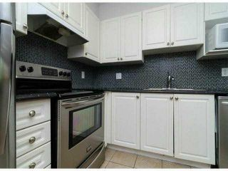 "Photo 4: 306 13955 LAUREL Drive in Surrey: Whalley Condo for sale in ""King George Manor"" (North Surrey)  : MLS®# F1422103"