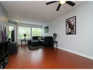 "Photo 6: 306 13955 LAUREL Drive in Surrey: Whalley Condo for sale in ""King George Manor"" (North Surrey)  : MLS®# F1422103"
