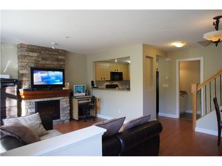 """Photo 2: 32 7428 SOUTHWYNDE Avenue in Burnaby: South Slope Townhouse for sale in """"LEDGESTONE 2"""" (Burnaby South)  : MLS®# V1000912"""