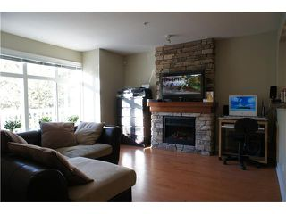 """Photo 4: 32 7428 SOUTHWYNDE Avenue in Burnaby: South Slope Townhouse for sale in """"LEDGESTONE 2"""" (Burnaby South)  : MLS®# V1000912"""