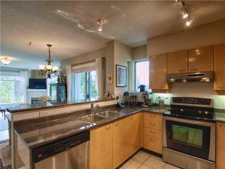 """Photo 1: 201 3625 WINDCREST Diversion in North Vancouver: Roche Point Condo for sale in """"WINDSONG PHASE 3 RAVENWOODS"""" : MLS®# V945947"""