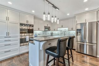 Photo 13: 549 POINT MCKAY Grove NW in Calgary: Point McKay Row/Townhouse for sale : MLS®# A1026968