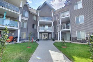 Photo 1: 2109 TUSCARORA Manor NW in Calgary: Tuscany Apartment for sale : MLS®# A1059226