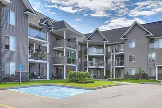 Photo 2: 2109 TUSCARORA Manor NW in Calgary: Tuscany Apartment for sale : MLS®# A1059226