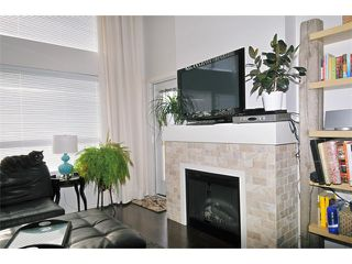 "Photo 1: 412 700 KLAHANIE Drive in Port Moody: Port Moody Centre Condo for sale in ""BOARDWALK AT KLAHANIE"" : MLS®# V935003"