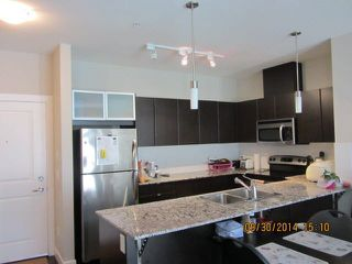 Photo 1: 217 9655 KING GEORGE BOULEVARD in Surrey: Whalley Condo for sale (North Surrey)  : MLS®# R2063280