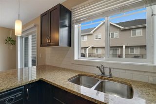 Photo 7: 10 675 ALBANY Way in Edmonton: Zone 27 Townhouse for sale : MLS®# E4202256