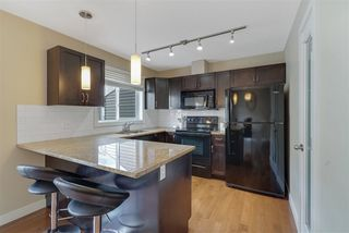 Photo 1: 10 675 ALBANY Way in Edmonton: Zone 27 Townhouse for sale : MLS®# E4202256