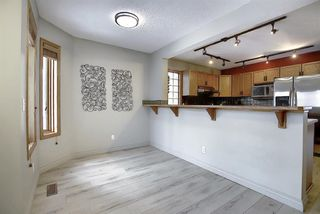Photo 5: 132 Inglewood Cove SE in Calgary: Inglewood Row/Townhouse for sale : MLS®# A1054327