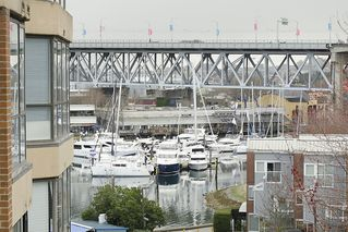 "Photo 1: 313 1490 PENNYFARTHING Drive in Vancouver: False Creek Condo for sale in ""HARBOUR COVE"" (Vancouver West)  : MLS®# V938539"