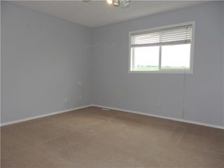 Photo 11: 566 FAIRWAYS Crescent NW: Airdrie Residential Detached Single Family for sale : MLS®# C3572126